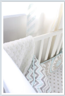 DIY painted nursery curtains in baby blue and white chevron stripes