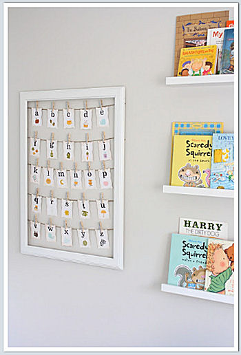 ABC nursery wall hanging beside the book shelf
