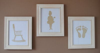 Create personalized nursery wall decor using your own Silhouette SD!<br><BR>This mom chose to frame a rocking chair, a fairytale ballerina and her baby's footprints in pink.  <BR><BR>The artwork looks amazing on the brown paint color of the nursery wall.