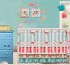 Modern Pink and Turquoise Baby Girl Nursery with Painted Turquoise Blue Dresser and Tissue Paper Pouf Ceiling Mobile