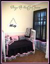 Custom silky pink black and white baby girl nursery room decorated in chenille and zebra pattern fabric