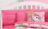 Fun bright pink monkey baby crib bedding and decorations for a girl nursery room.