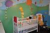 The baby's nursery is based on the Lorax Dr Seuss nursery