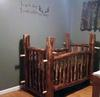 An enchanting hunting baby nursery theme with a natural wood crib made by dad using reclaimed wood from the forest where he and Jace's mom hunt.