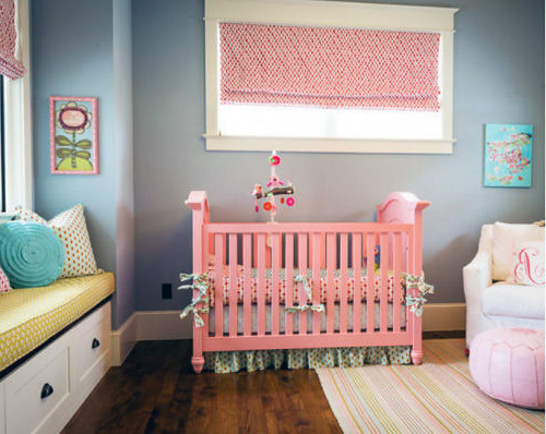 Transitional baby nursery with a crib painted pink.