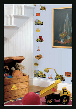 Dump trucks, cement mixers and colorful dirt diggers are so cute on a baby boy's nursery wall.