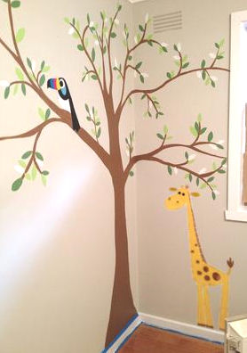 A Tree Wall Mural in a baby girl nursery room with toucan bird and a giraffe