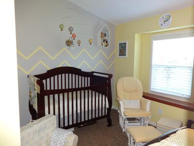 View of my baby girl's grey and yellow hot air balloon nursery theme.