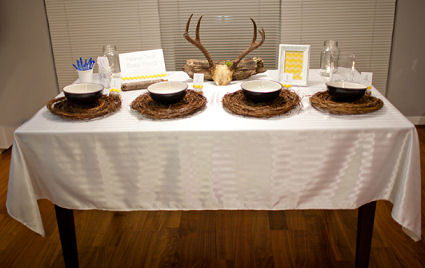 Deer horns baby shower centerpiece and soup bowls on rustic chargers