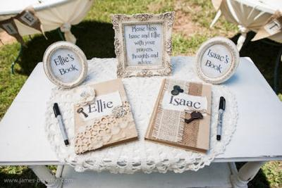 Guests are invited to share prayers, special thoughts and advice in personalized books at the entrance to the two sisters' vintage baby shower