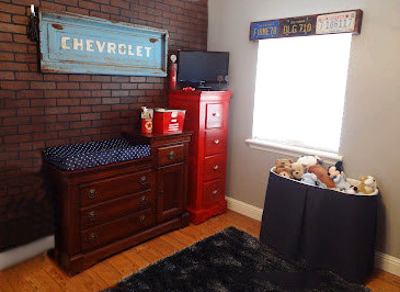Classic vintage car themed baby nursery for a boy with antique Chevrolet truck memorabilia collectibles DIY decor
