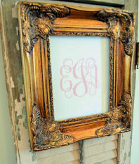 Elegant pink monogram with a baby girl's initials in a vintage picture frame