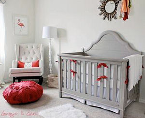 Elegant Florida theme nursery room decorated for a baby girl with coral pink flamingos