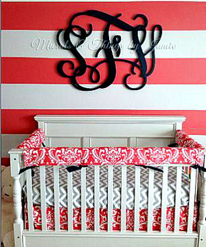 Watermelon pink nursery wall paint color used in a striped wall painting technique