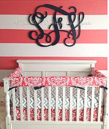 Black wooden wall monogram with a baby girl's initials for a pink nursery wall