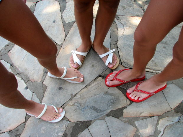 Pregnant mommies-to-be wearing stylish flats thongs and sandals to accommodate their swollen feet and ankles