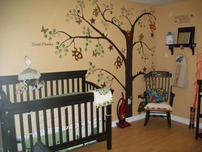 Our hand-painted tree wall mural with monkeys swinging through the branches surrounded by fluttering butterflies.