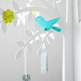 Wishing tree baby shower centerpiece with paper pink and blue bird decorations on the branches
