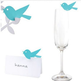 Pink or blue paper birds make excellent baby shower decorations perched on the rim of water or wine glasses