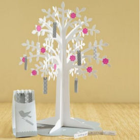 Baby girl wishing tree shower centerpiece with hot pink flowers as decorations