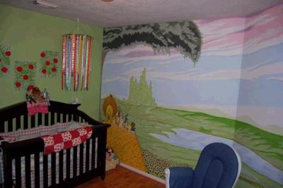 The Wizard of OZ nursery mural, the mobile, the poppy canvases, and her crib