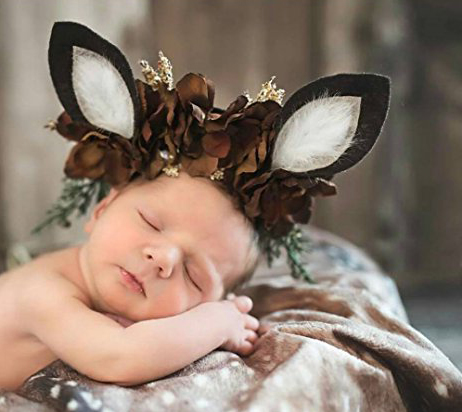 Newborn baby photo posing idea.  Infant pose with deer ears wrapped in baby fawn print blanket photo prop.