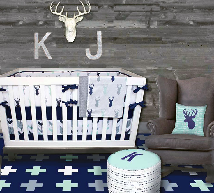 Rustic woodland forest animals deer baby nursery theme decorating ideas in mint green, navy blue and white.