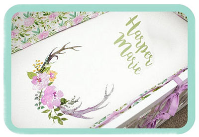 Lilac lavender forest woodland deer theme personalized crib bedding set for a baby girl nursery room.
