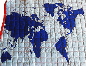 World map applique quilt pattern for a baby nursery or kids room bedding