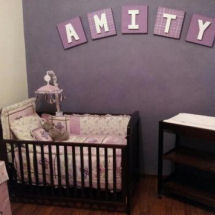 Baby girl purple nursery with purple and ivory wall paint color lavender crib bedding and large wooden wall letters