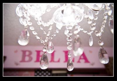 Luxurious crystal chandelier in Annabella's princess nursery.