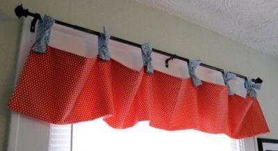 Red and blue homemade tie-top nursery window valance