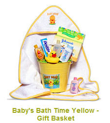 Baby duck theme bath baby shower gift basket.  A yellow rubber ducky a personalized bath towel, soap and shampoo make a lovely presentation.