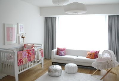 Beautifully decorated baby girl nursery room in pink gray  and white with a Moroccan silver metallic pouf accent decoration