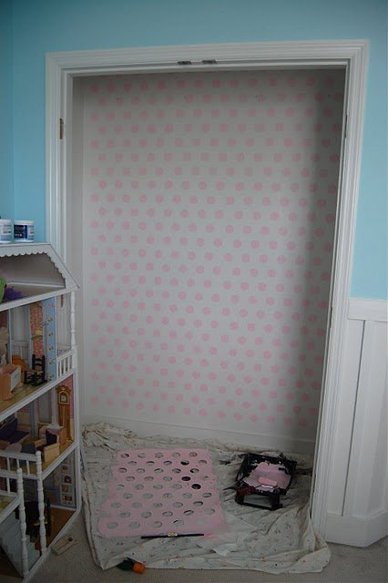 The plain, white closet walls before Tiffany gave them their painted polka dot makeover.