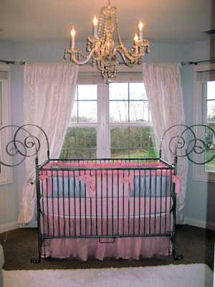 Elegant modern pink blue and white baby girl princess nursery with crystal chandelier