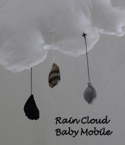 handmade homemade rustic rain cloud baby crib nursery mobile fabric burberry raindrops