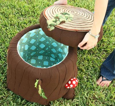 Upholstered tree stump forest theme storage compartment stool with mushrooms for a baby nursery room