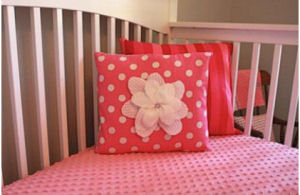 A pink and gray nursery for a baby girl nursery.