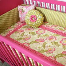 Hot pink and green floral baby girl nursery with custom made floral crib bedding