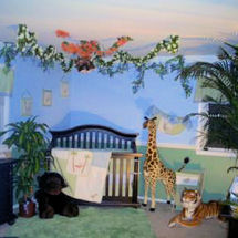 Neutral jungle themed nursery with giant stuffed giraffes, tigers and monkey theme baby crib bedding