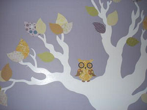 Lavender baby owl theme baby girl nursery with lavender wall paint and homemade fabric tree wall mural.