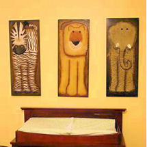 Safari jungle baby nursery theme with a diamond wall painting technique and brown giraffe print crib bedding