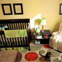 Disney characters theme baby boy nursery with painted wall mural and polka dots nursery area rug