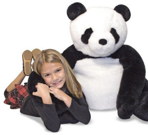Giant plush stuffed panda bear toy for a baby nursery or kids room
