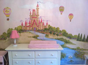 Baby girl pink and white changing table area with a princess castle mural on the nursery wall