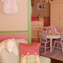 Pink, antique white and green vintage baby girl nursery with polka dot fabrics and victorian wall decorations