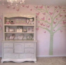 Pink tree wall decal with butterflies in a pink and white baby girl princess nursery