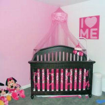 Hot pink and white princess nursery with a pink gauze princess crown canopy and damask print crib set