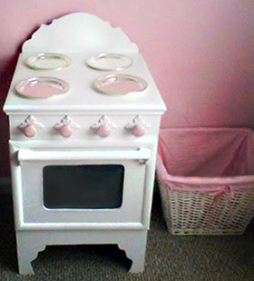The wooden pink and white princess stove we made using woodworking plans we found online is so sweet and only cost $25!